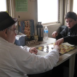 Our very own hobo, Terry Miller, playing checkers